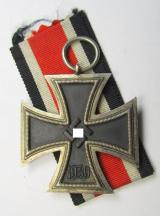 Iron Cross 2nd class (or: 'EK II. Klasse') being a non-maker-marked example that comes together with its full-length ribbon (ie. 'Bandabschnitt') as was (IMO) produced by the: 'Wilh. Deumer'-company