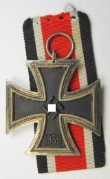 Iron Cross 2nd class (or: 'EK II. Klasse') being a maker- (ie. '15'-) marked example that comes together with its original ribbon (ie. 'Bandabschnitt') as was produced by the: 'Friedrich Orth'-company