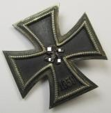 'Eisernes Kreuz 1. Klasse' (or: Iron Cross 1st class), being a maker- (ie. '6.'-) marked example as was produced by the 'Hersteller' (ie. maker): 'F. Zimmermann' and that comes in a regrettbly somewhat damaged- ie. denazified condition