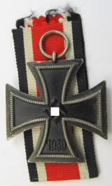'Eisernes Kreuz II. Klasse' being a non-maker-marked example that comes together with its original piece of ribbon (ie. 'Bandabschnitt') as was produced by the company: 'Beck, Hassinger & Co.' based in the town of Strassbourg