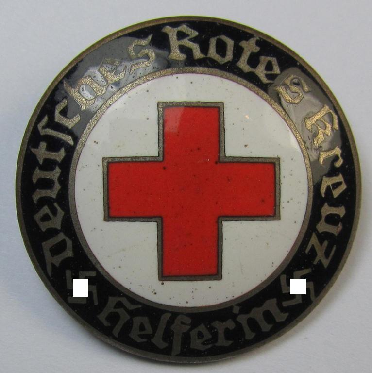 Attractive example of a DRK (ie. 'Deutsches Rotes Kreuz' or German Red Cross) nurses'-badge as was intended for a: 'Helferin' being a non-maker-marked example that comes in a fully untouched condition