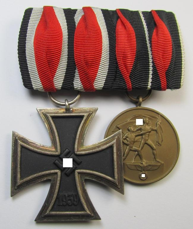 Superb, two-pieced medal-bar (ie. 'Ordenspange') showing resp. an: 'Eisernes Kreuz II. Klasse' and and a Czech 'Anschluss'- (ie. occupation-) medal: '1. Oktober 1938' that both come period-mounted as a (detachable!) 'Doppelspange'