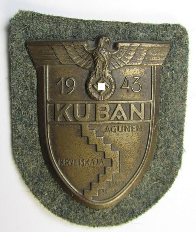 Attractive - and actually scarcely encountered! - WH (Heeres ie. Waffen-SS) 'Kuban'-campaign-shield that comes mounted onto its original field-grey-coloured- and/or woolen-based 'backing'