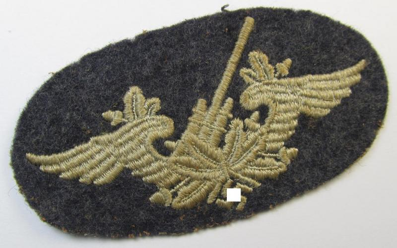 Neat, machine-embroidered WH (Luftwaffe) trade- ie. special-career-patch as was intended for: 'Flak-Artillerie'-staffmembers (that comes in a cleary worn- ie. once tunic-attached, condition)