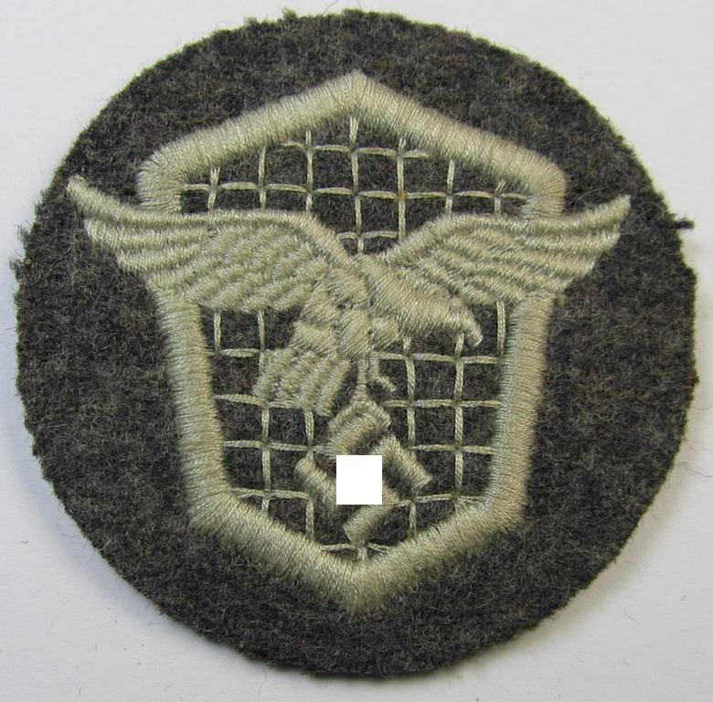 Neat, machine-embroidered WH (Luftwaffe) trade- ie. special-career-patch as was intended for: 'Kraftfahr'-staffmembers (that comes in a cleary worn- ie. once tunic-attached, condition)