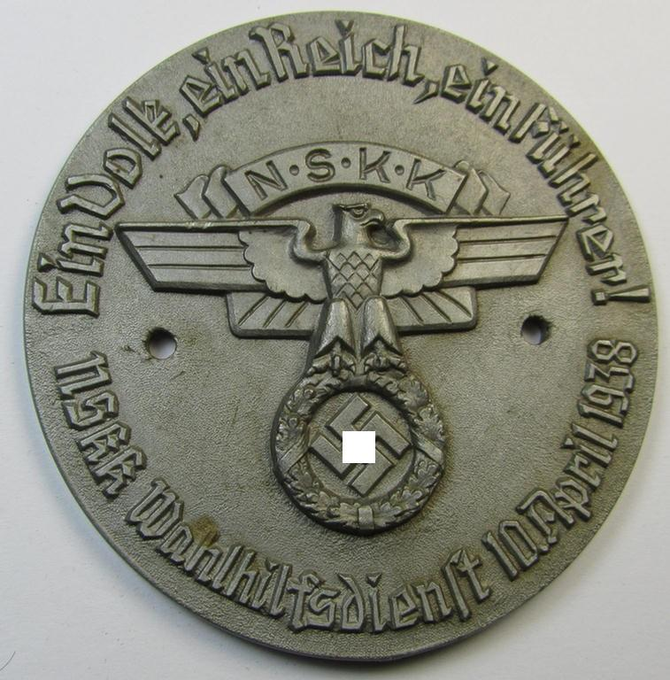 Greyish-silver-coloured- and/or 'molded'-resin-based, N.S.K.K.- (ie. 'National Socialistisches Kraftfahr Korps-') related plaque (ie. 'Plakette') bearing the text: 'Ein Volk, ein Reich, ein Führer! - NSKK Wahlhilfsdienst - 10. April 1938'