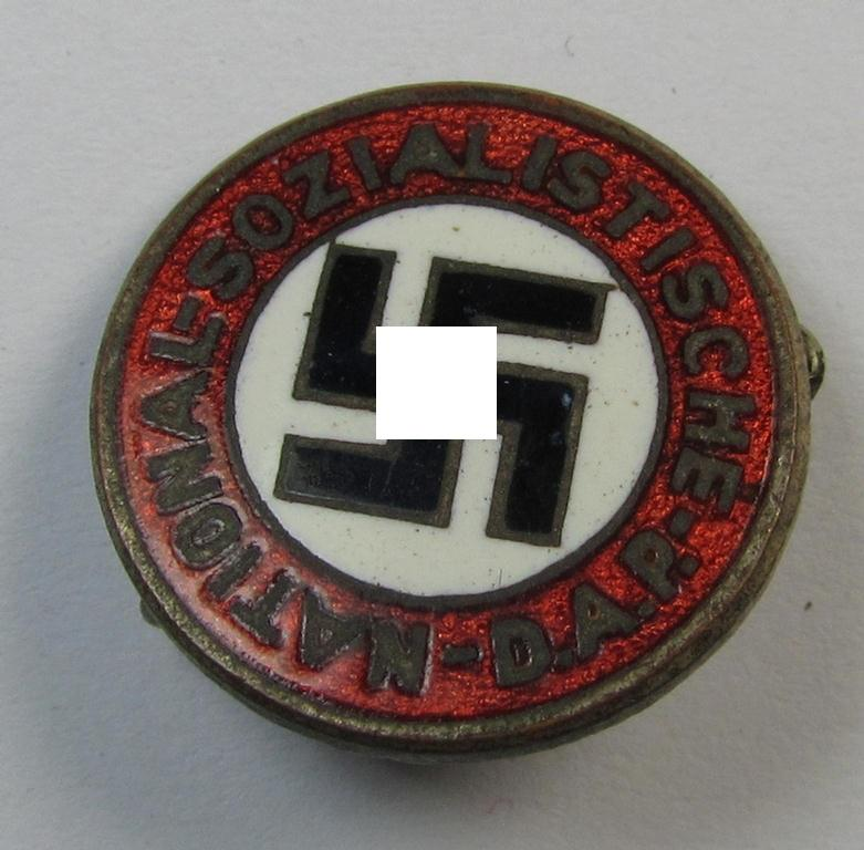 Superb, smaller-sized- (ie. 'variant'-pattern-) neatly enamelled 'N.S.D.A.P.'-membership-pin- ie. party-badge (or: 'Parteiabzeichen') being a clearly maker- (ie. 'Hoffstätter'-) marked example showing a 'Ges.Gesch.'-designation