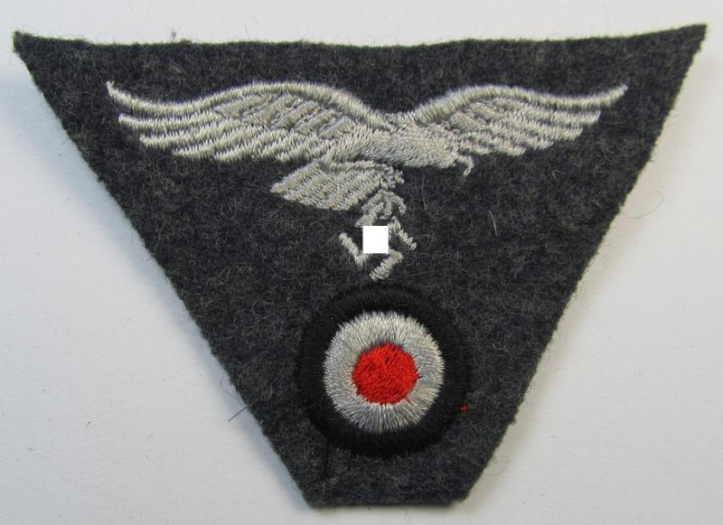 Attractive - and scarcely encountered! - WH (Luftwaffe) so-called: 'M43-pattern'-cap-trapezoid (being a machine-embroidered example that is executed on a bluish-grey-coloured- and/or woolen-based background)