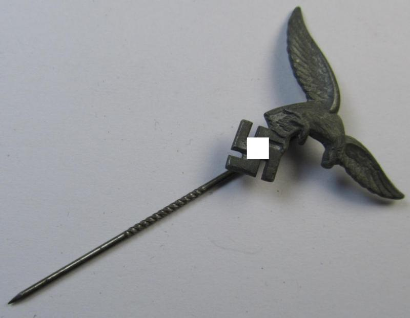 Silverish-grey-toned lapel-pin (ie. 'Zivilabzeichen') to be worn on the civil attire as was intended for usage by the various staff-members of the 'Luftwaffe' (depicting an early-pattern- ie. 'down-tailed'-eagle)