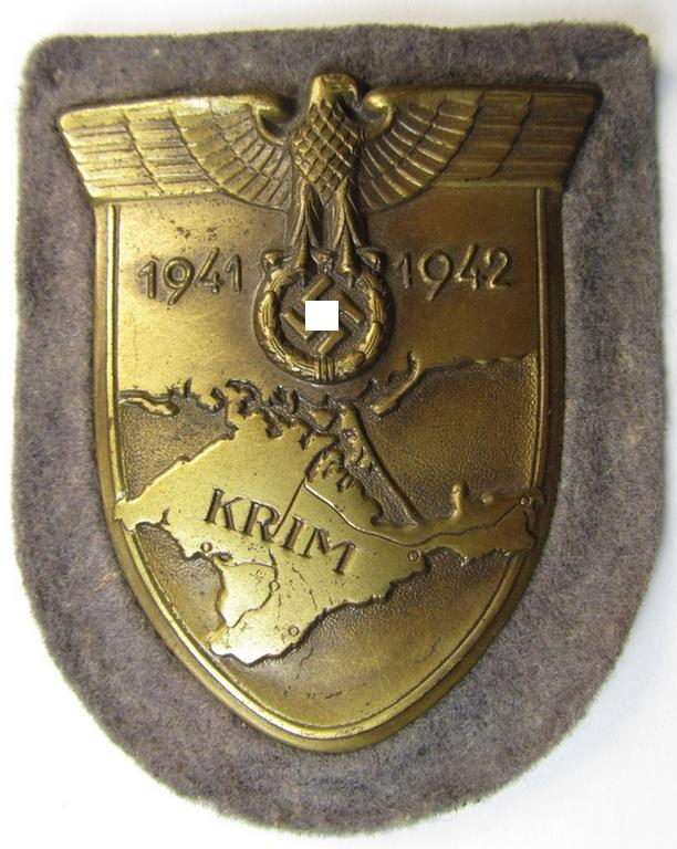 Superb, WH (Luftwaffe) 'Krim'-campaign-shield that comes mounted onto its original, bluish-grey-coloured 'backing' and that comes in an issued- (albeit never worn- nor tunic-attached-, condition)