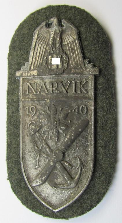 Superb - and actually rarely encountered! - WH (Heeres) 'Narvik'-campaign-shield being a detailed example as was executed in silver-toned zinc- (ie.'Feinzink') and that comes in a clearly issued- (albeit never tunic-attached-), condition