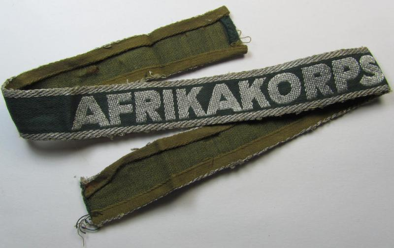 Superb, 'BeVo'-like cuff-title (ie. 'Ärmelstreifen') entitled: 'Afrikakorps' being a with certainty issued and truly worn example that comes in an overall nice- (ie. non-shortened- and most certainly once tunic-attached-), condition