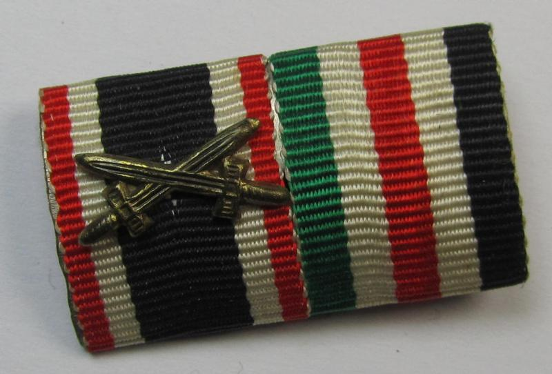 Two-pieced, WWII-period (ie. DAK-related!) medal-bar (ie. 'Band- o. Feldspange') showing resp. the ribbons for a: 'KvK II. Klasse m. Schw.' and a: 'Deutsch-Italienische Feldzugsmedaille'