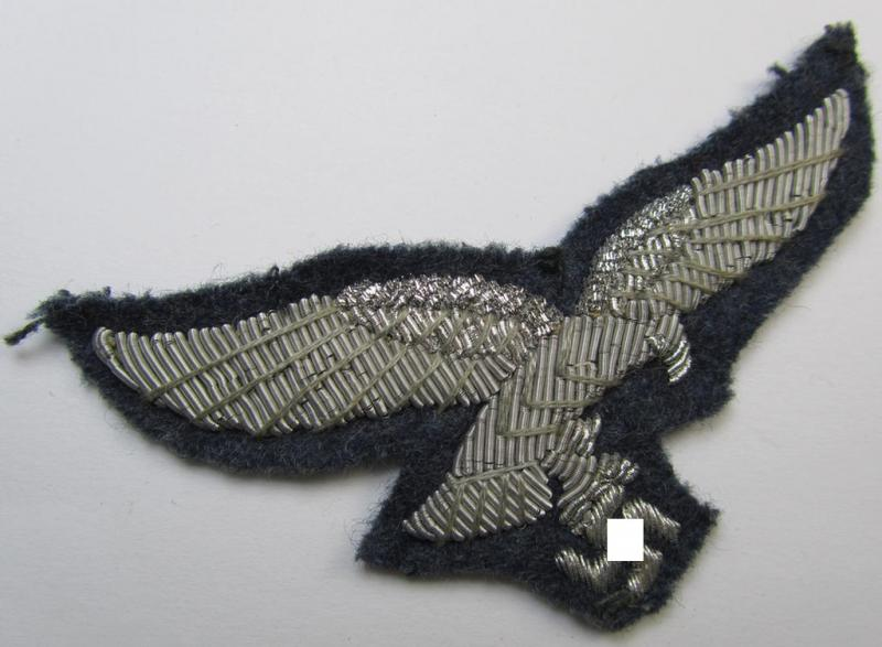 Attractive, WH (Luftwaffe) officers'-pattern breast-eagle (ie. 'Brustadler für Offiziere') being a neatly hand-embroidered example that comes on a typical officers'-pattern, greyish-blue-coloured- and/or woolen-based background