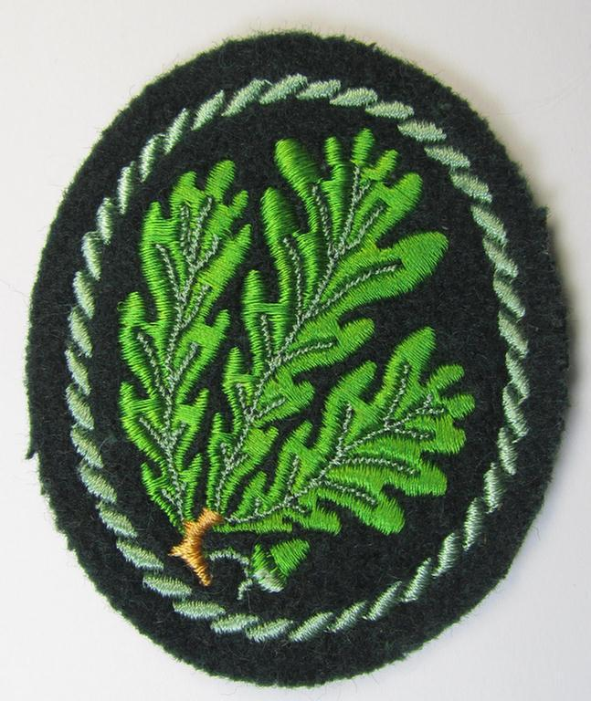Attractive example of a WH (Heeres) so-called: 'Jäger'-armbadge, being a neatly machine-embroidered- and/or multi-coloured version as was executed on darker-green-coloured wool
