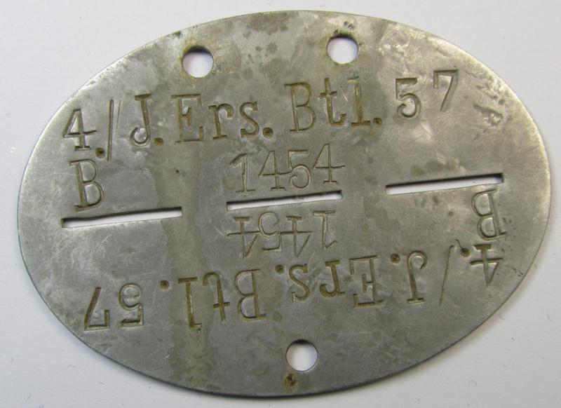 Aluminium-based, WH (Heeres) ie. 'Infanterie'-related ID-disc bearing the clearly stamped unit-designation that reads: '4./J.Ers.Btl. 57' and that comes as issued- and/or worn