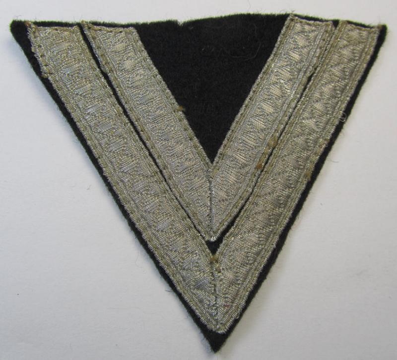 Moderately used, Waffen-SS-type 'Armwinkel' (or: rank-chevron) as executed on black-coloured wool as was intended for an: 'SS-Rottenführer'