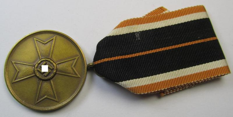 Neat, 'Kriegsverdienstmedaille 1939' being a non-maker-marked- and/or: 'Buntmetall'-based specimen that came mounted onto its (truly orange-red-coloured- and fairly long-sized!) ribbon (ie. 'Bandabschnitt')