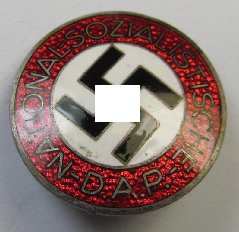 Neatly enamelled- (and bright-red-coloured) 'N.S.D.A.P.'-membership-pin- ie. party-badge (or: 'Parteiabzeichen') which is nicely maker-marked on the back with the makers'-designation: 'RzM' and/or: 'M1/63'