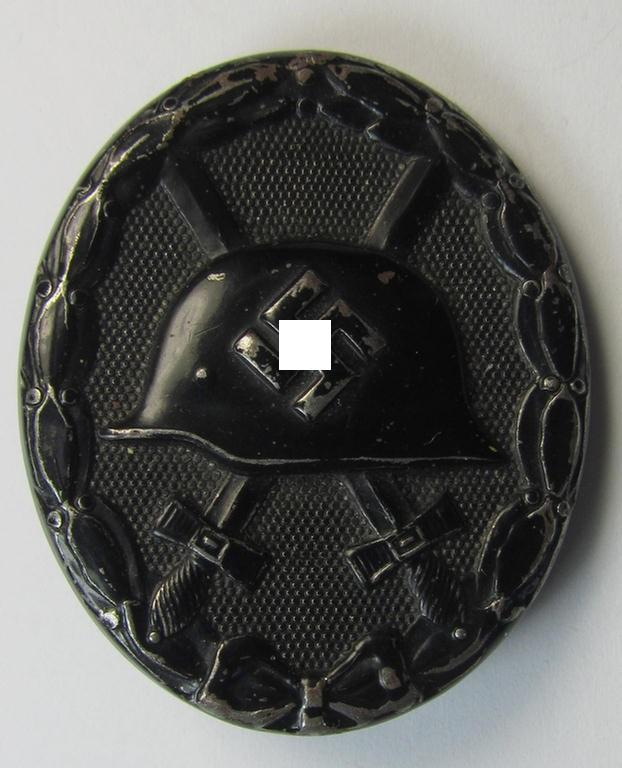 Attractive, non-maker-marked example of a black-class wound-badge (or: 'Verwundeten-Abzeichen in Schwarz') that comes in an overall nice- (ie. moderately used- ie. worn-), condition