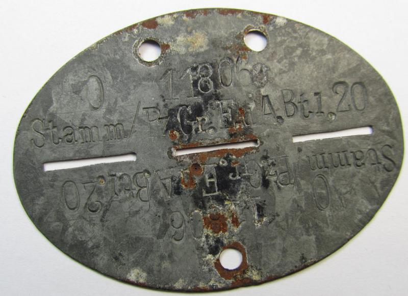 Later-war-period, zinc-based WH (Heeres-) ie. 'Panzer-Grenadiere o. Infanterie'-related ID-disc bearing the clearly stamped unit-designation that reads: 'Stamm/Pz.Gr.E.u.A.Btl. 20' and that comes as issued- and/or recently found