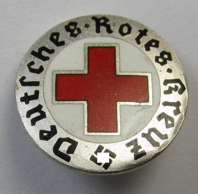 Multi-coloured- and/or neatly enamelled DRK (ie. 'Deutsches Rotes Kreuz') civil-attire badge (ie. 'Zivilabzeichen des D.R.K.') being a very detailed example that is void of a makers'-mark but that shows a 'Ges.Gesch.'-patent-designation