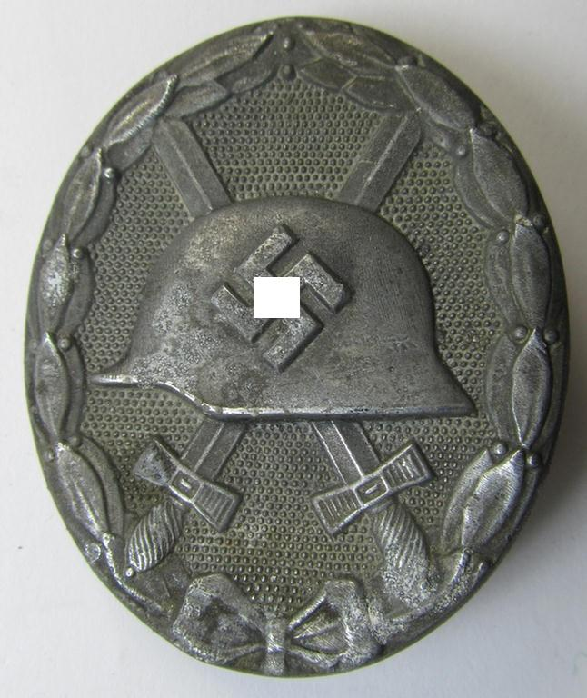 Moderately used, non-maker-marked example of a silver-class wound-badge (or: 'Verwundeten-Abzeichen in Silver') being a typical zinc- (ie. 'Feinzink'-) based example